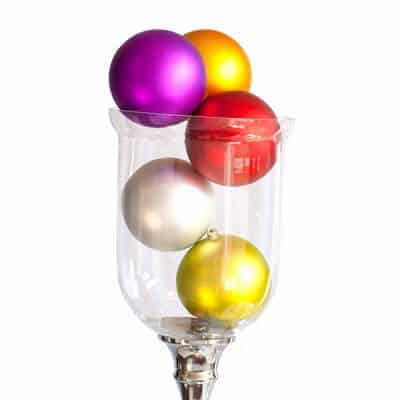 Clear vase filled with various coloured matt baubles