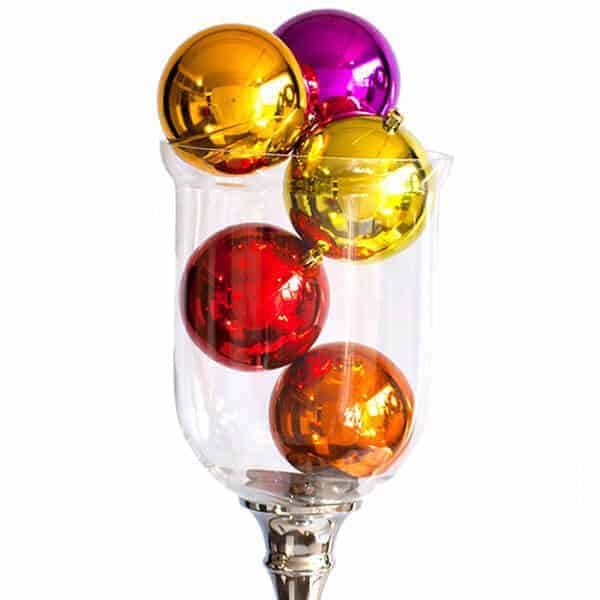 CLear vase of various coloured shiny baubles