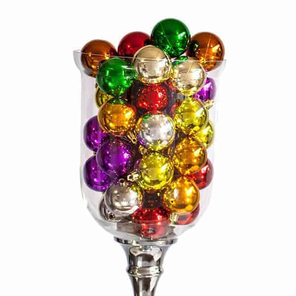 C:ear vase filled with Shiny Christmas baubles