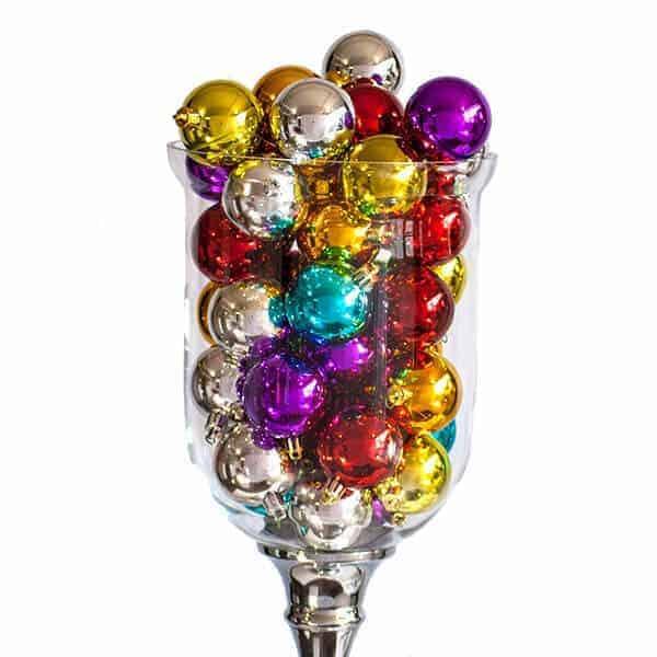 Clear jar of UV Christmas baubles