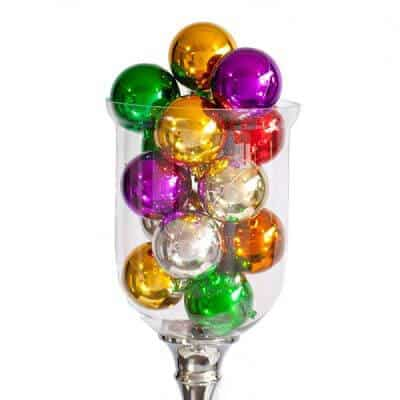 Clear vase filled with shiny Christmas baubles