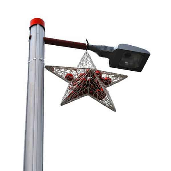 White star filled with red baubles hanging from street light pole