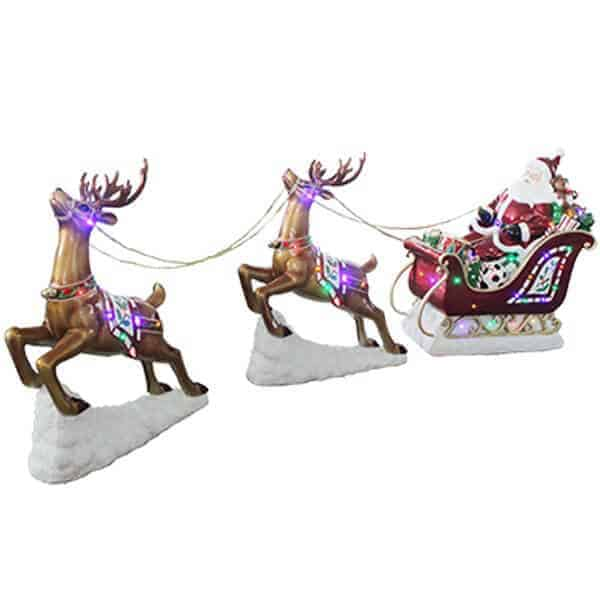 Santa in a sleigh with presents being pulled by two reindeer prop