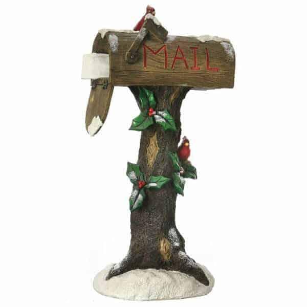 Snowy mailbox on tree stump prop